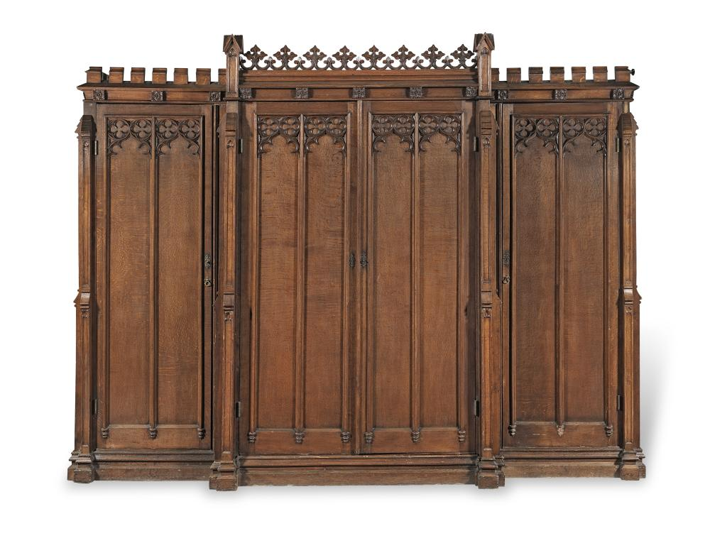 An early Victorian gothic revival oak breakfront wardrobe in the manner of Thomas King