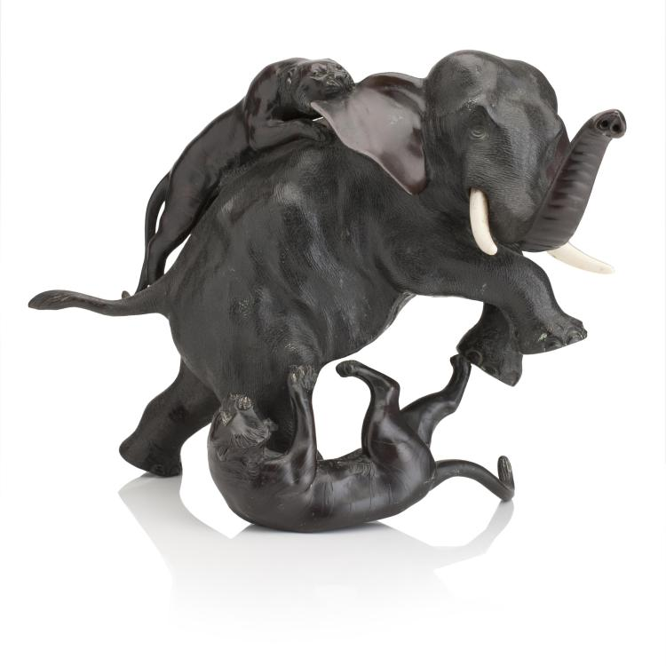 A bronze group of two tigers attacking an elephant Asian Art