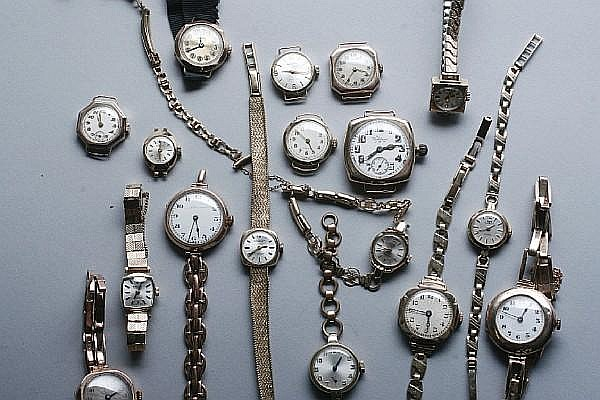 A collection of lady's gold cased wristwatches