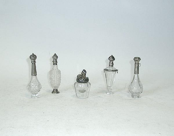 A late 19th/early 20th century Austrian Art Nouveau clear glass and silver mounted glue pot, by Georg Adam Scheid, Vienna, circa 1900, and four scent bottles (5)