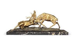 E. Guy, possibly Edouard Guy Comte Du Passage (French, 1872-1925): A gilt bronze animalier group of 'Combat de Cerfs', circa 1920