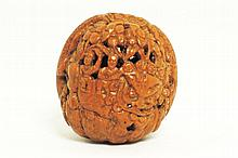 A fine Chinese openwork walnut shell, fully carved