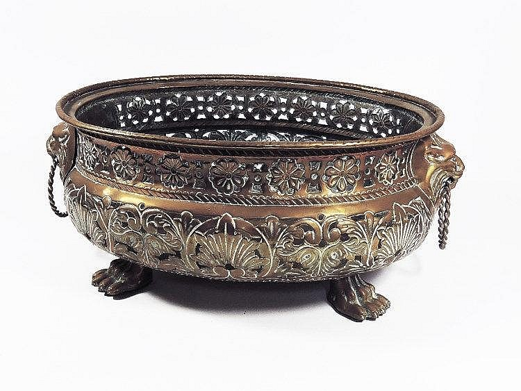 A Brass Oval Jardiniere With Pierced Body With Lion S Mask H