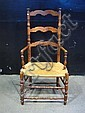 ARM CHAIR: An 18th C. Canadian chestnut ladderback open arm chair.