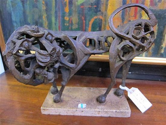 RHODEN, JOHN W. (AMERICAN, 1918-2001): Bronze lion figure. Dark brown patina. On a travertine base.