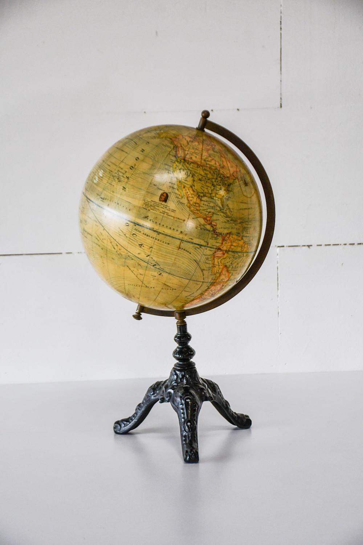 "Early World Globe on Iron Stand 23""H, 13"" x 12""(diam.)"
