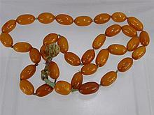An Antique Chinese Butterscotch Amber Necklace, ap