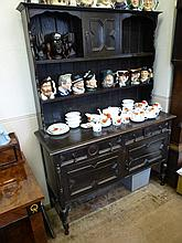 A Stained Oak Dresser, three short drawers with tw