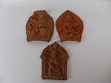 Three Terracotta Wall Plaques, depicting Indian de