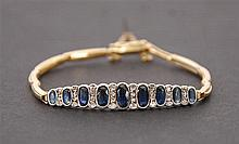 Bracelet Or jaune. Serti de neuf saphirs et de brillants.