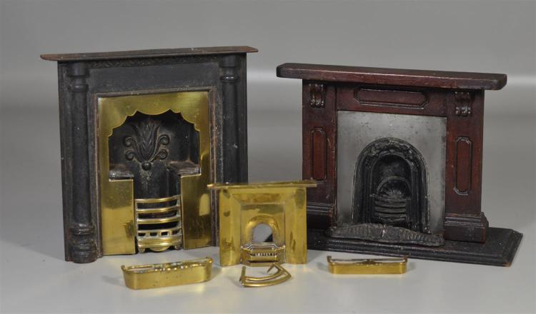 (2) cast iron, wood, and brass salesman sample Victorian firepace inserts, tallest 9 3/4