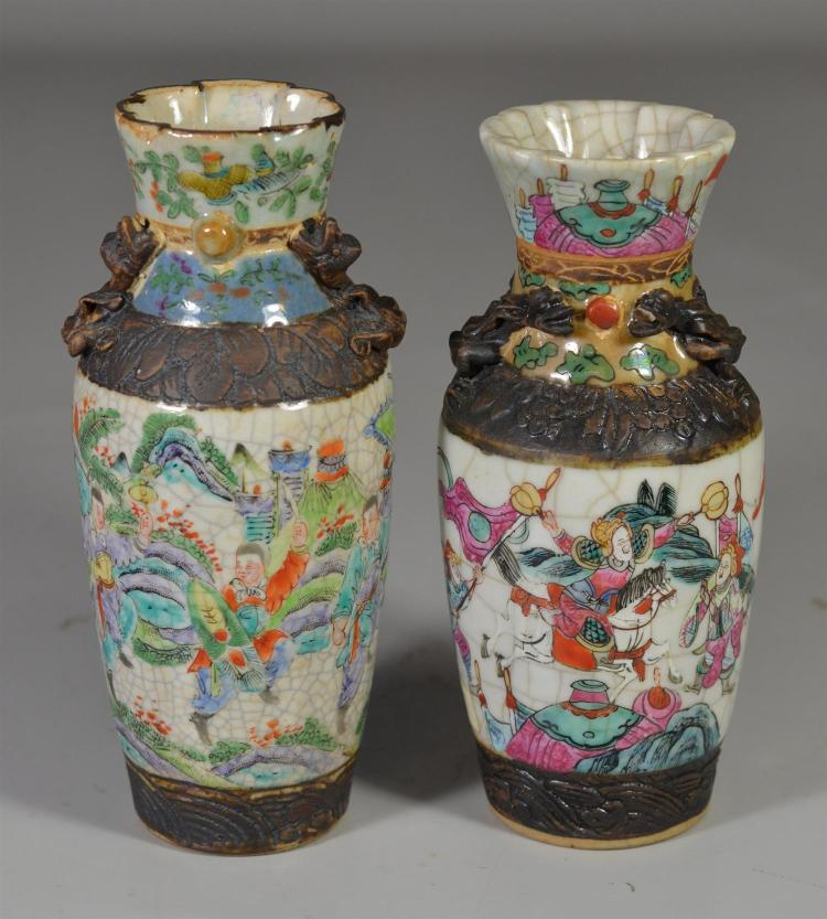 (2) Chinese enameled vases, both with warrior scenes and both marked to base, tallest 7 7/8