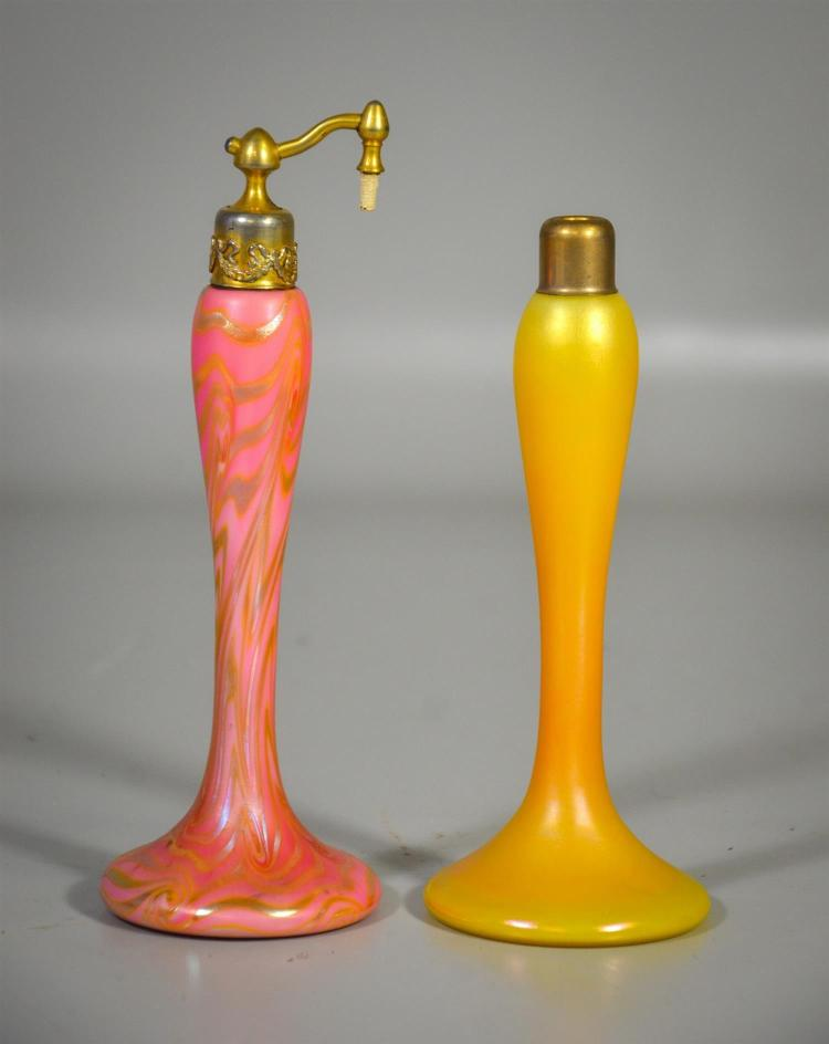 (2) unsigned iridescent atomizers, one with Durand King Tut type decoration, the other plain gold, one with top, no bulbs, tallest 7...