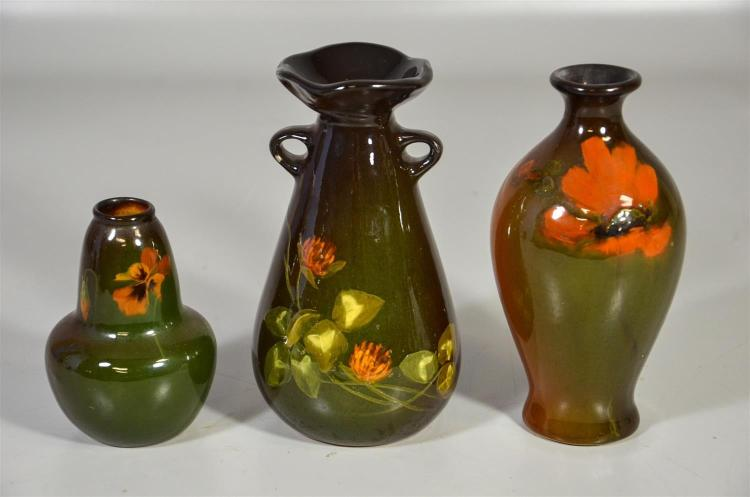 (3) Weller Louwelsa vases, floral decorated, double handle, artist mark T, 7