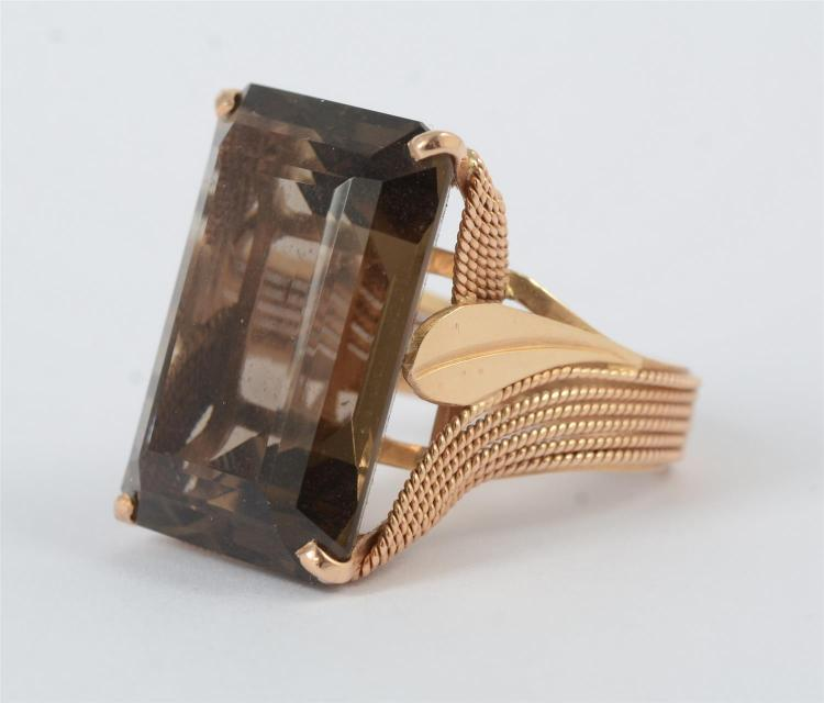 14K YG ladies fashion ring, featuring a 4 prong set center rectangular step cut smoky quartz, medium dark tone, about 34 carats, bea...