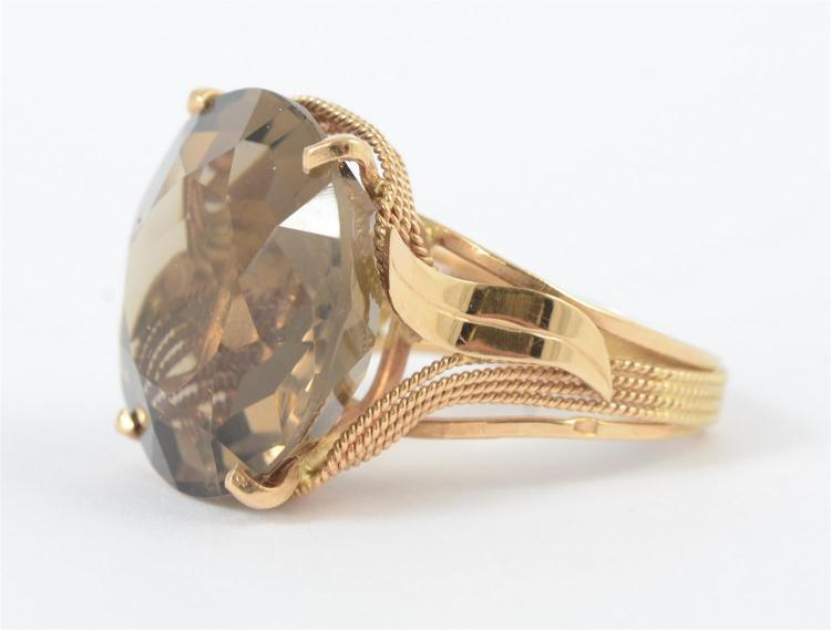 14K YG ladies fashion ring, featuring a 4 prong set center round faceted smoky quartz, medium dark tone, about 30 carats, beaded wir...