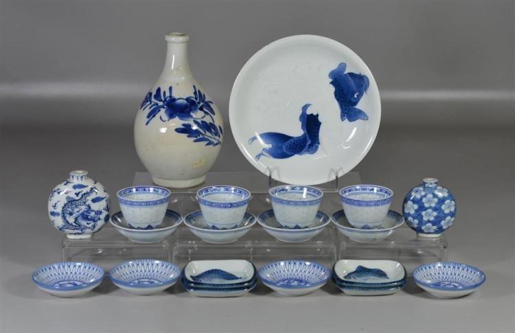 20 Pieces of Asian blue and white porcelain to include a Japanese carp plate, two (2) sets of four (4) each sauce dishes, two (2) la...
