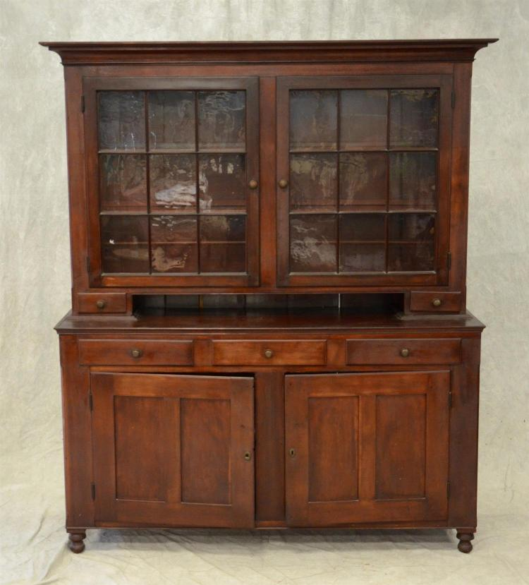 2-Piece cherry Dutch cupboard, top section with 2 9-pane doors concealing shelves with spoon racks, 2 candle drawers, base with 3 sh...
