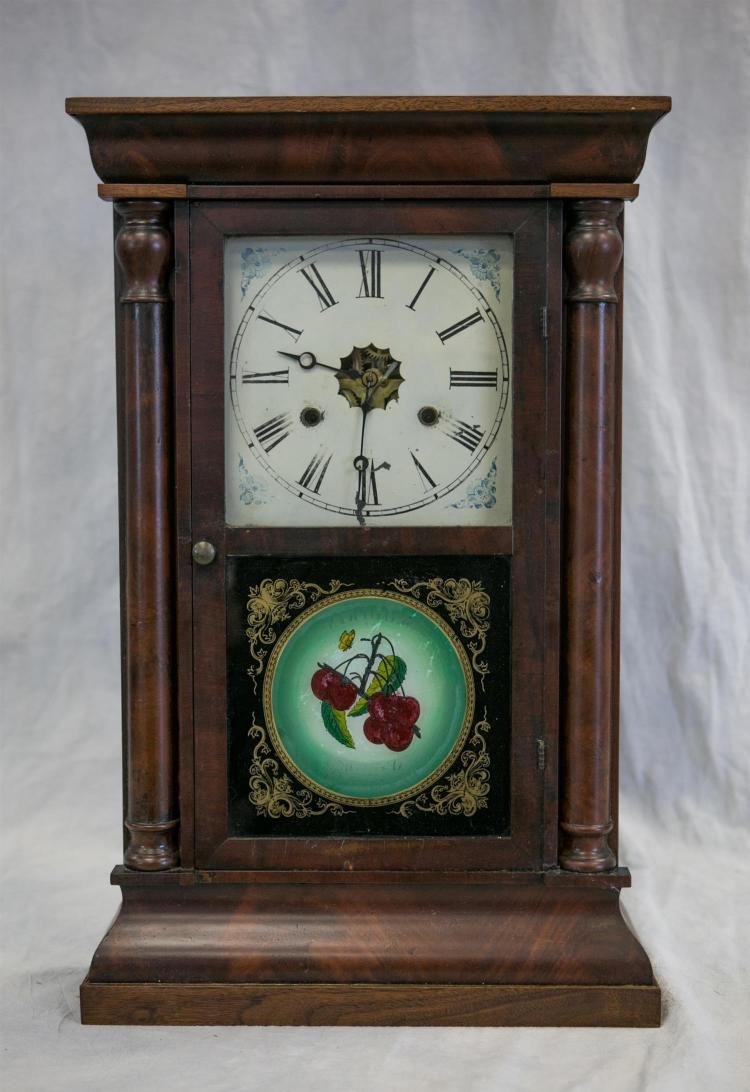 American Clock Co mahogany column form shelf clock, with bell strike, paper label intact, but difficult to read, with weights, pendu...