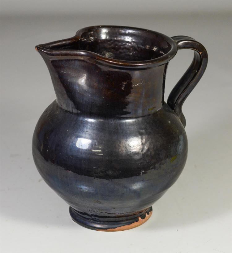 Black glazed bulbous redware pitcher,  8