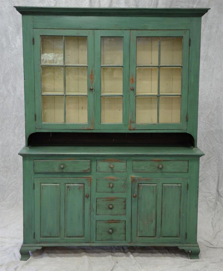 Blue-green painted softwood 2 pc Dutch cupboard, 18th c to with 2 six pane doors, newer base with 3 short drawers over 2 raised pane...