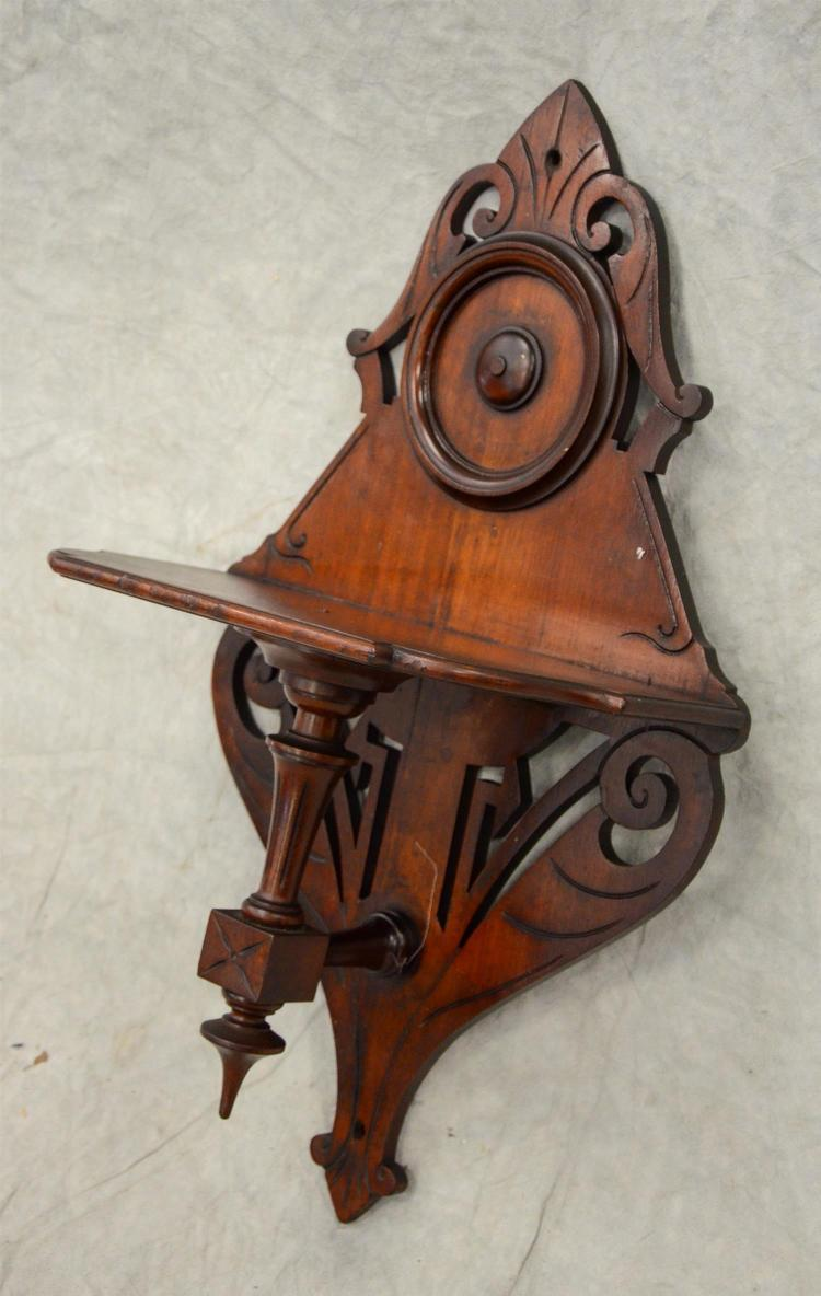 Carved walnut Victorian wall shelf, 27 1/2
