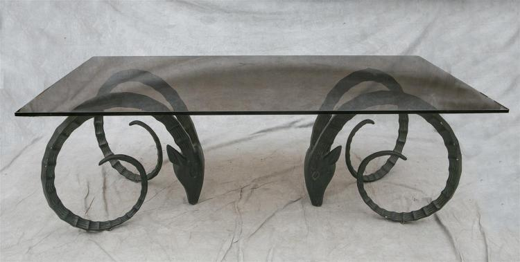 Cast metal rams head dining table with smoked glass top, 7'' x 4'', 30
