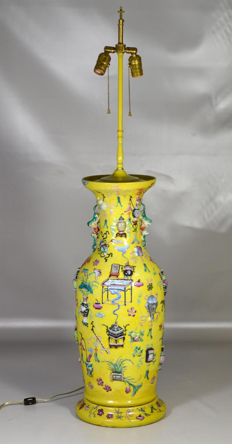Chinese 19th century yellow ground porcelain vase, foo dog handles, extensive raised decoration, old restoration to rim, height of v...