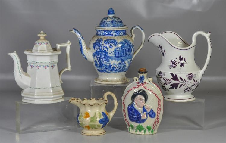 Five (5) pieces of English pottery to include a large pitcher, two (2) teapots, small pitcher and a flask with a pipe smoker, talles...