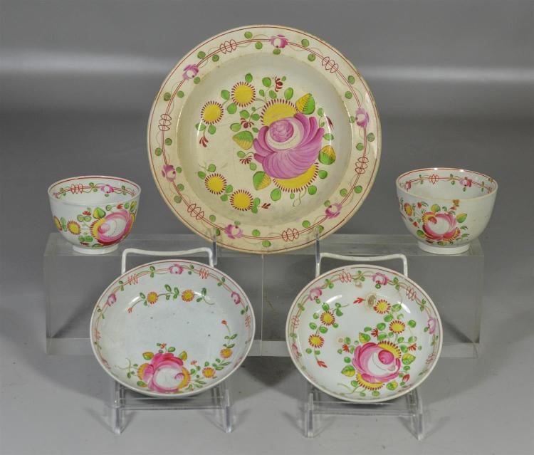 Five (5) pieces of Queen''s Rose soft paste to include a shallow soup bowl and 2 cups and saucers, most with condition issues, 8 3/8 ..