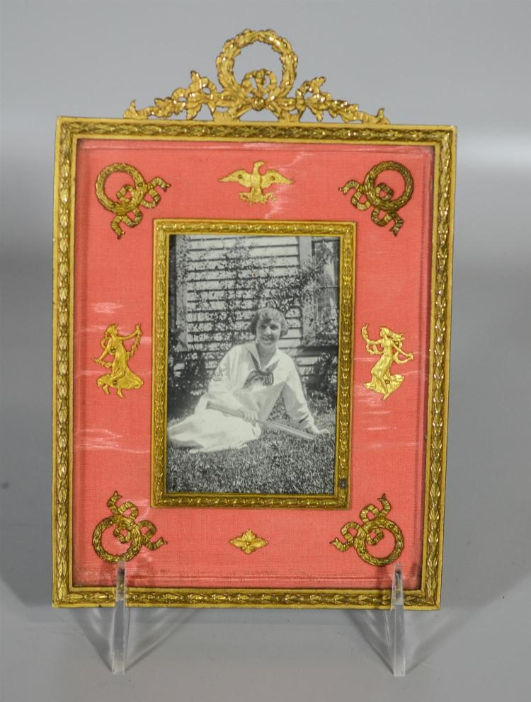 French ormolu Empire style picture frame, silk decorated with eagle, wreaths, dancing maidens, wreath top, leather back marked