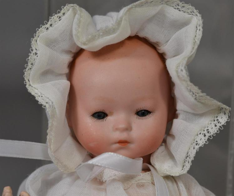 German solid dome bisque head baby doll, sleep eyes, closed mouth, painted hair, 5-piece composition body, marked
