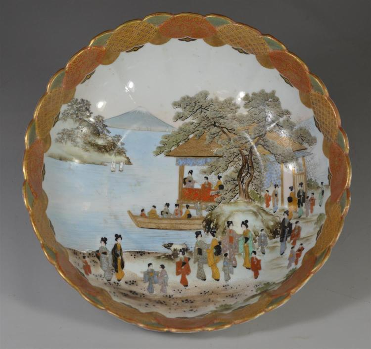 Japanese Kutani fluted bowl with elaborate pavillion scene with maidens on shoreline, mountains in the distance, brocaded border, 11...