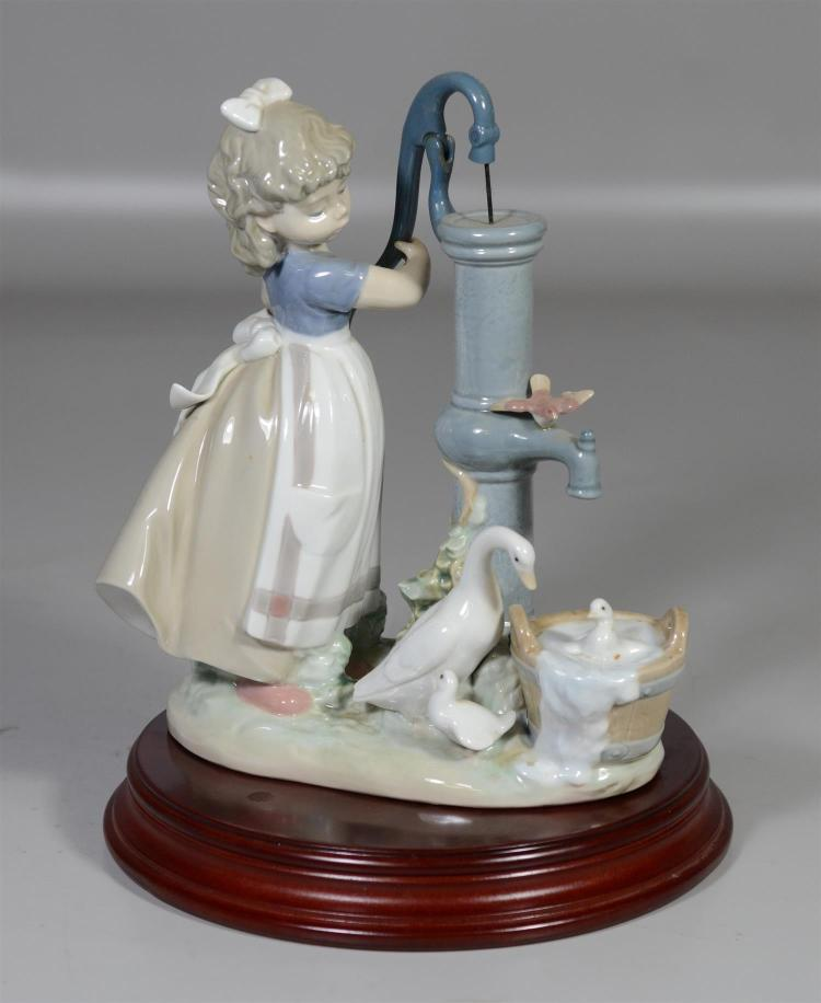 Lladro figurine, Girl by Water Pump with Ducks, 9 1/2