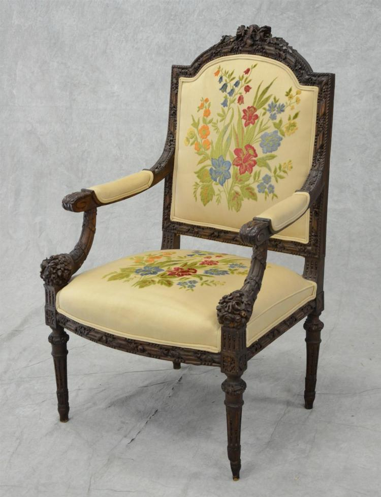 Louis XVI style floral carved walnut bergere, floral upholstery, 45 1/2