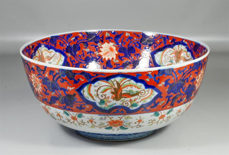 Massive Japanese Imari punchbowl, large old repair on one side, 18