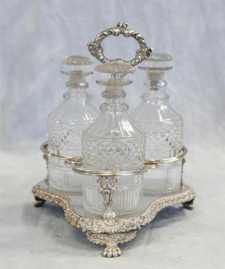 Ornate 3 bottle plated silver decanter stand, 3 crystal decanters, total ht 11