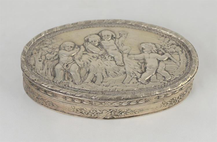 Oval Dutch silver trinket box, lid with repousse scene of cherubs and goat cavorting, floral bands around body, 5 1/8