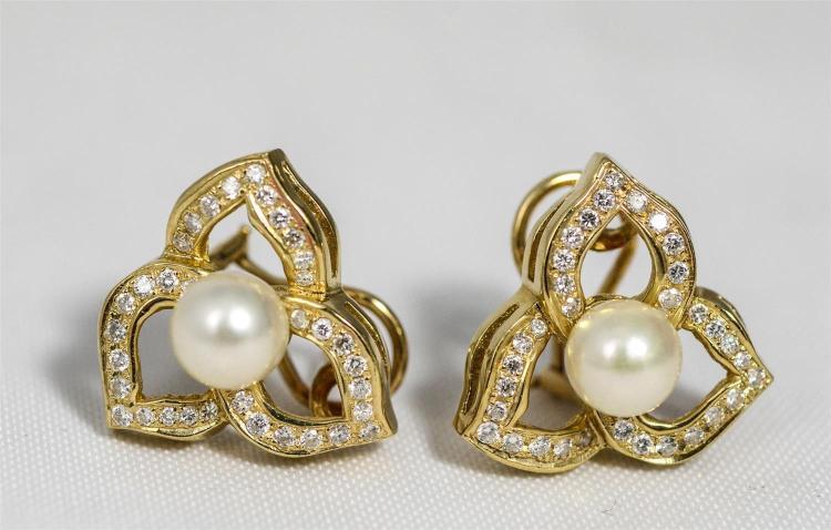 Pr custom made 14K YG diamond and pearl earrings, an 8 mm pearl centering 3 diamond encrusted petal form elements, each with 11 roun...