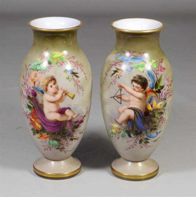 Pr French opaline vases, handpainted scenes of cherubs with instruments, each with a series of 4 exposition seals/stamps on bottoms,...