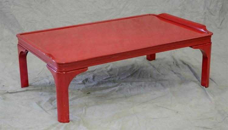Red lacquered Asian style coffee table, 51