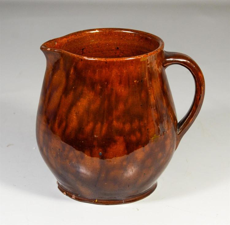 Redware pitcher with manganese splotched decoration, 7