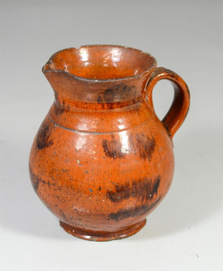 Redware pitcher with manganese splotched decoration, molded strap handle, 6 3/4