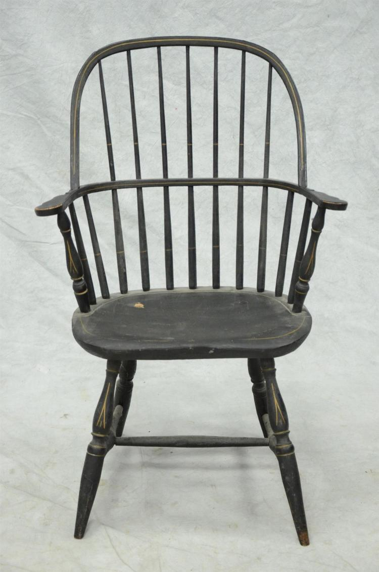 Sackback Windsor armchair, saddle seat, crusty black paint with pinstripe decoration, a few old repairs, 39