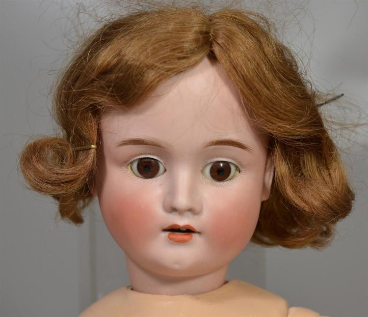 Schoenau & Hoffmeister bisque head doll, mold #1906, wig firmly glued on, set eyes, open mouth with teeth (one missing), repainted j...