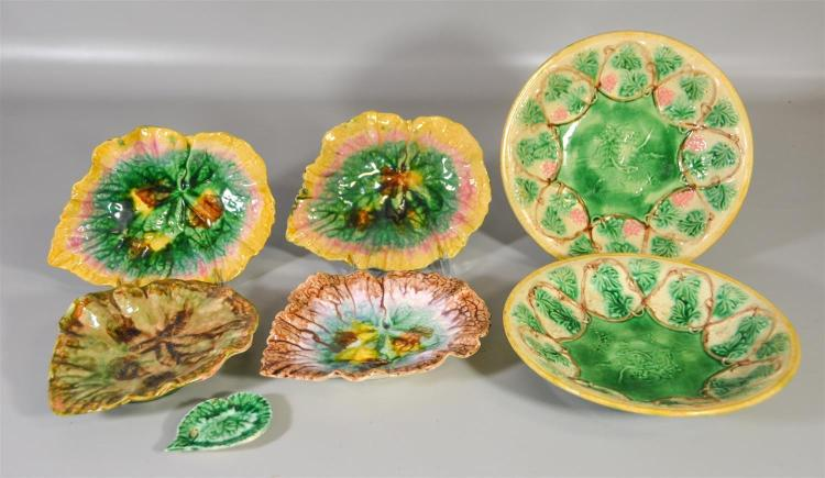 Seven (7) pieces of Etruscan majolica, all marked to base, 4 leaf dishes, 2 bowls and a small leaf dish, largest 10