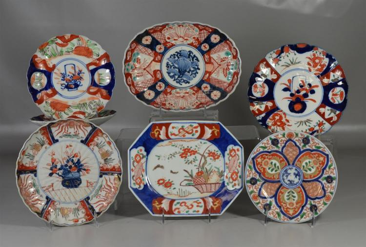 Seven (7) pieces of Japanese Imari porcelain to include five (5) plates and two (2) serving pieces, largest 7 1/2