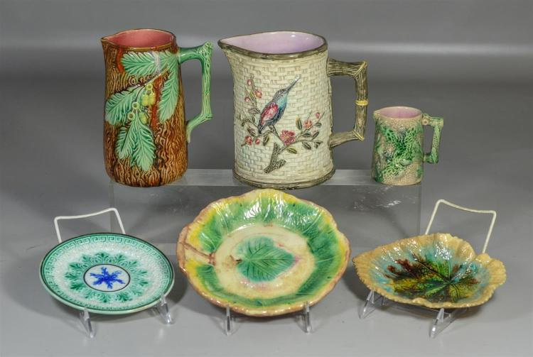Six (6) pieces of majolica to include three (3) pitchers, a leaf dish and two (2) plates, tallest 7 1/4