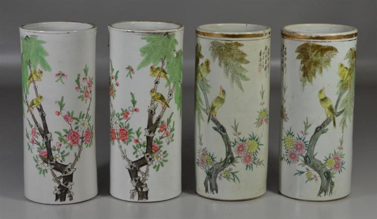 Two pair of Chinese porcelain hat stands both painted with birds on branches, tallest 10 1/2