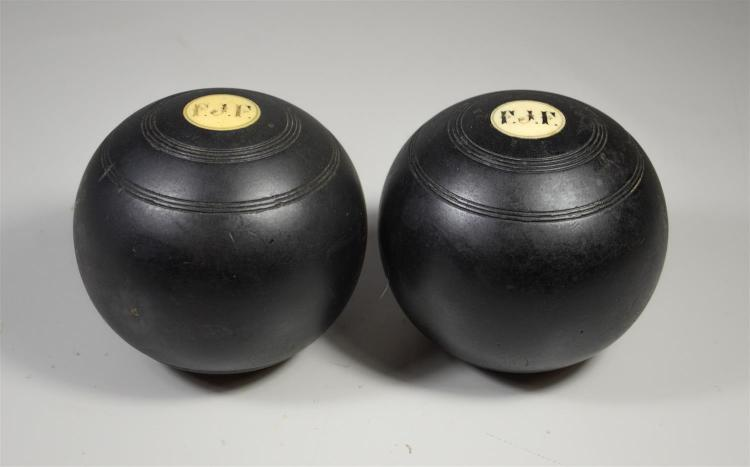 Two Traditional wood gaming balls with bone inserts, approx 4-3/4